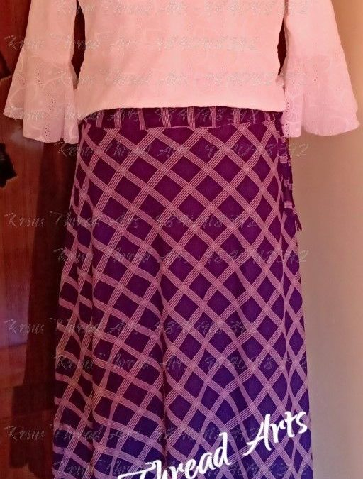 Maxi skirt with high neck peplum top and bell sleeves by student Shushmitha